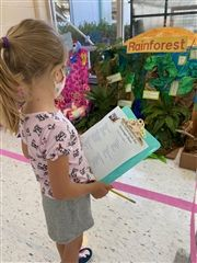 A student works on her eyes only scavenger hunt while visiting the third grade's ecosystems at Norfolk Collegiate.