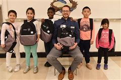 Connection, represented by Chris Humann, donated 42 backpacks to the school.
