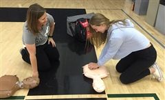 Athletic Trainer Meaghan Beaudoin and junior Kayla Gratzer-Von Lintel.
