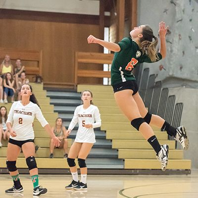 Volleyball player Libby '19 jumps for the hit