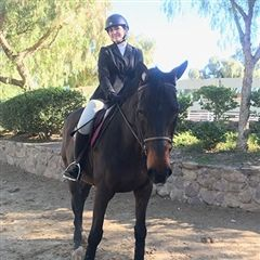 Emer '21 on a competition horse