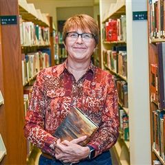 Renee Hawkins stands in the library
