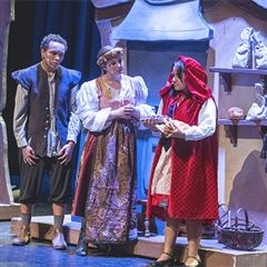 The baker and his wife speak with Red Riding Hood