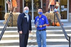 MS Math Teacher Ryan Kho accepts award from  GISA vice president Stan Whitlock