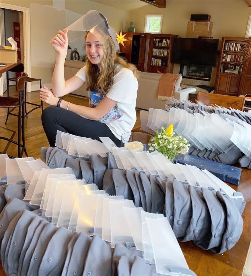 Julia crafts over 200 face shields to keep healthcare workers battling COVID-19 safe.
