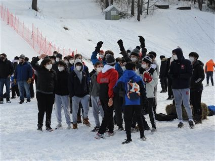 Members of Kravis House celebrating after competing in the first-ever all school relay race at Eaglebrook's 99th Winter Carnival on February 6, 2021.