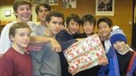 Members of the Ski Team with presents they were wrapping for Adopt-a-Family