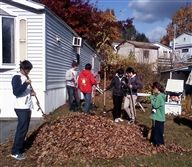 Eaglebrook students raking leaves at the home of a hospice patient
