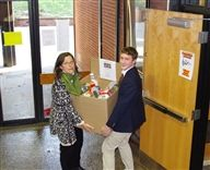 Transporting food collected in the Learning Center for the food drive.