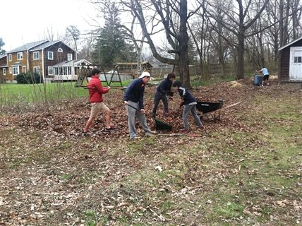 Eaglebrook students raking the yard of a Hospice patient