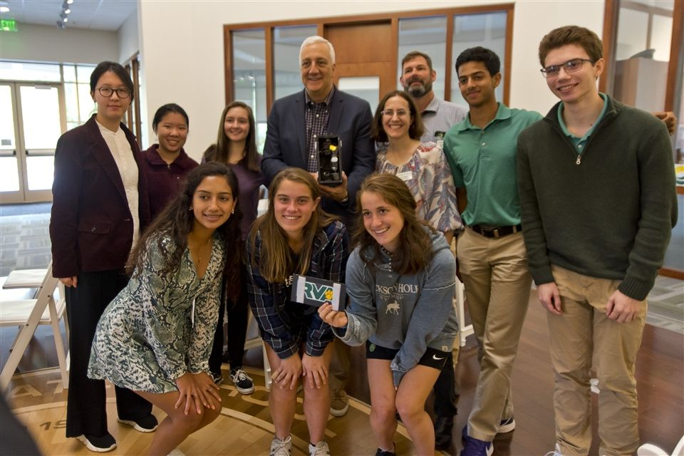 Students pose with former NASA astronaut Dr. Michael Massimino and their science experiment.