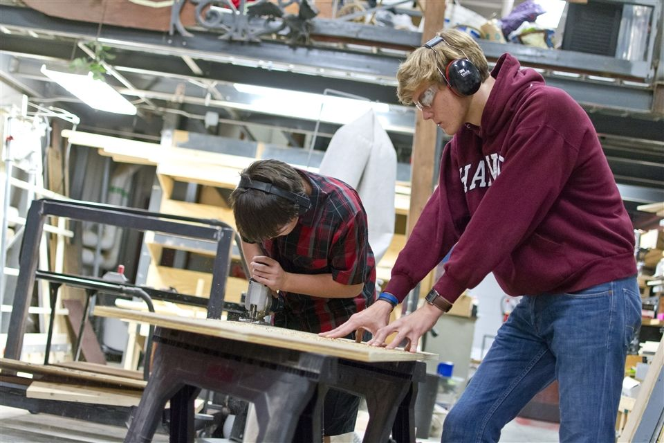 Crüe members intently focus on building a set piece for Pippin
