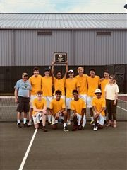 Boys' Tennis proudly displaying their trophy with coaches Karin Whitt and Mike Finsterwald