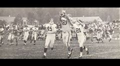 A Rick Wiltshire-to-Alex Smith (23) pass completion set up a touchdown against Woodberry Forest in the opening game of the 1963 football season