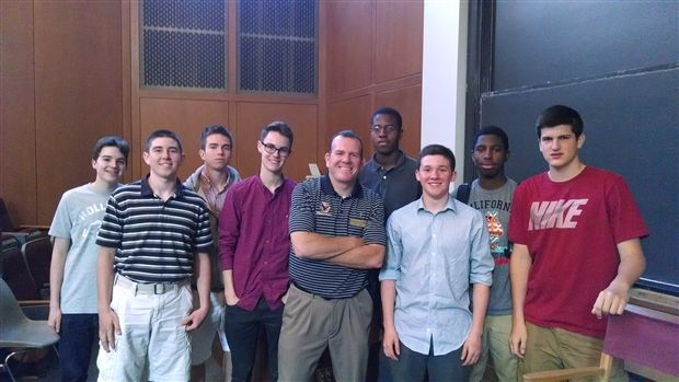 Boston College Associate Director of Admissions Chris O'Brien '90 with a  group of