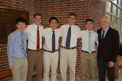 National merit semi-finalists pictured with Steve Hughes