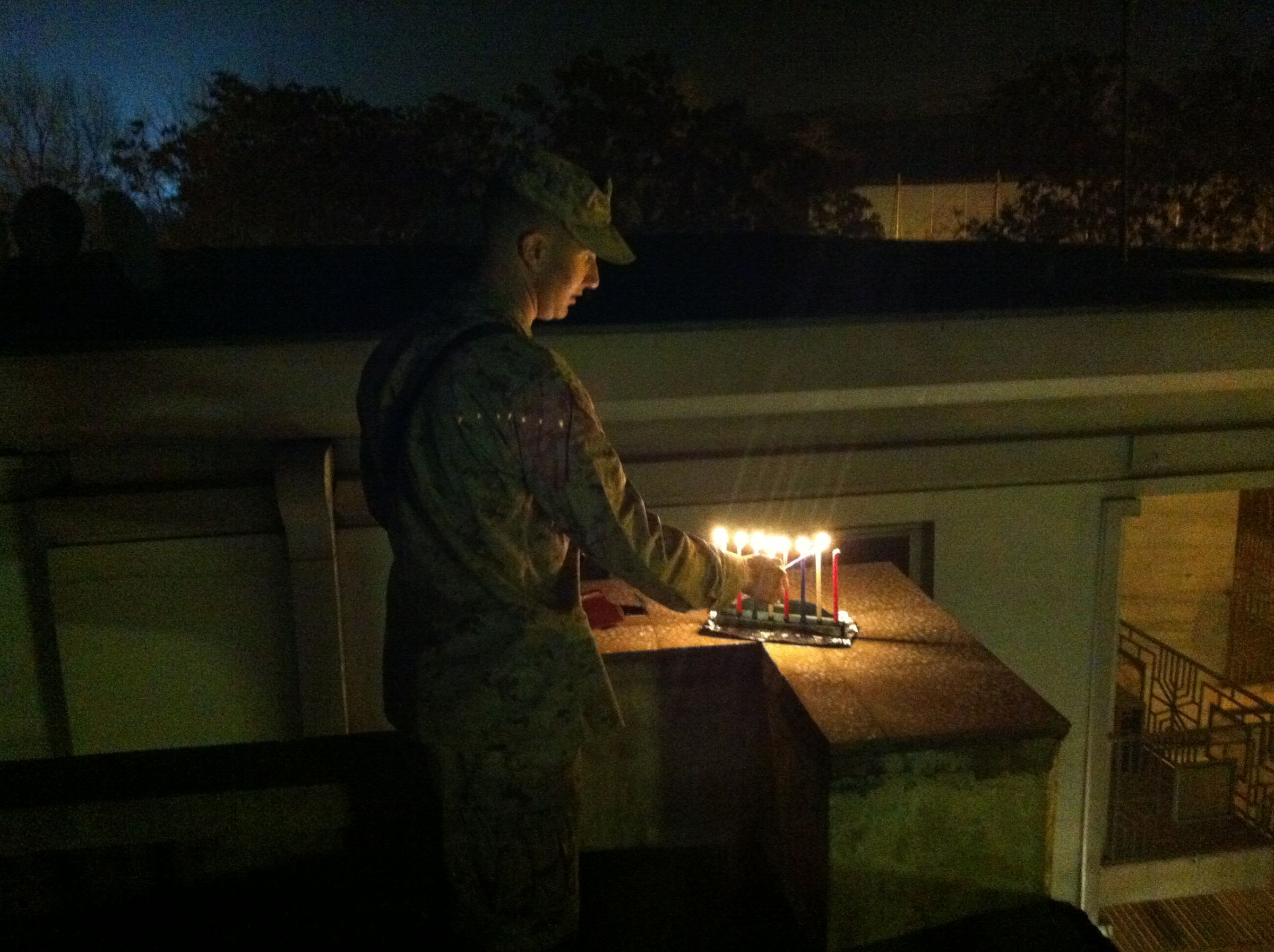 BT alum Josh Chinsky '01 lighting the Menorah in Kabul, Afghanistan