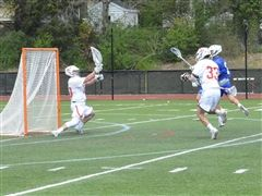 Michael Chapman '18 makes a save against Atlee.