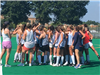 Norfolk Academy's varsity field hockey team comes together as practice ends on August 8, 2019.