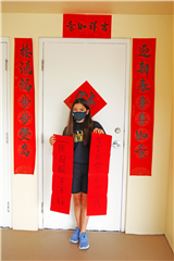 Eighth-grader Vanessa Smoleny shows off the couplets created in class.