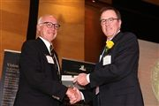 Pat Shannon, right, receives the Speirs Medal from former colleague Geoff Dowd