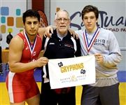 From left: Sam Barmish, Selwyn House Wrestling Coach Rob Moore, and Alex Moore in 2016