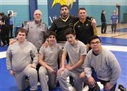 Standing, from left: Coaches Rob Moore, Sam Barmish and Noel Tremblay. Kneeling: Ben Kaufmann (Gr. 9), Sam Telio, Michael Gubitosa and Sean Vinh.