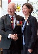 Carol Manning receiving the Sovereign's Medal from Governor General David Johnston in 2017.