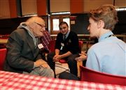 Dr. Raynold Gold chats with students during a Contactivity visit to Selwyn House in November