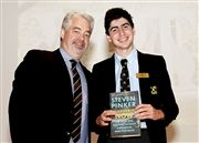 Jonah Rosen receiving a prize from Assistant Headmaster and Head of Senior School Mike Downey