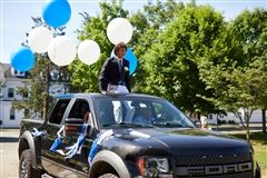Rett Zeigler of Rowayton, recipient of the Johansen Award for compassion and a sense of community, arrived in a parade of cars.