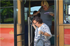 Alumni exited the trolley on Saturday after a leisurely drive around campus and extended campus, which included a tour by former Senior Master Bob Gardiner.