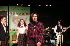 Lexi Williamson '18 performing as Dewie in School of Rock, The Musical.
