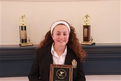 Carly Fischer '17 with her All-State plaque and first place trophies for Slalom and Giant Slalom.