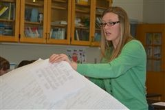 Science teacher Lauren Kelly explains concept mapping to fellow faculty members
