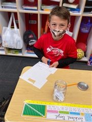 "Locklend B. works on his ""Gratitude Jar"" as part of the guidance lessons presented to his Grade 3 class by Ms. Taria Conley, Lower School Guidance Counselor."