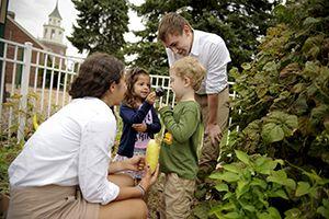 Upper School students in garden with Preprimary students.