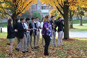 Upper School photography students outside in the fall.