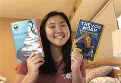 Paige L. with two books she read recently in English class.