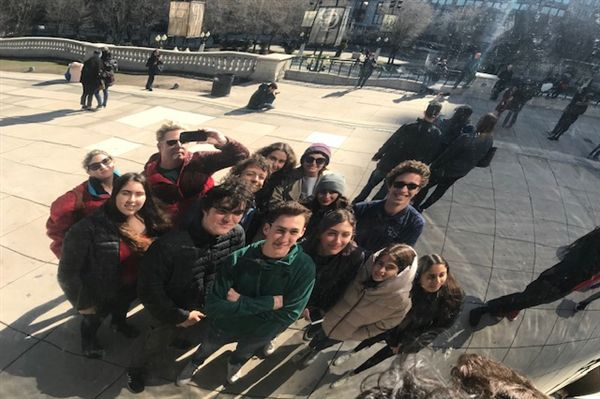 Crossroads students on the Model United Nations team visit the Cloud Gate sculpture in Chicago.