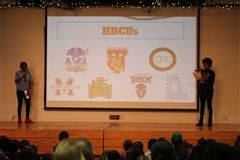 Middle School students discuss historically black colleges and universities (HBCUs) during an Elementary School assembly.