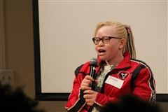Bibiana Mashamba, a Tanzanian teenager who has albinism, shares her story with Crossroads students.