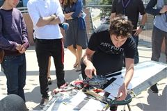 Noah Treiman tinkers with the solar-powered plane that he built for his Senior Project.