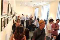 Members of the School community gather in Sam Francis Gallery for the Zipper Archives exhibit's opening reception.