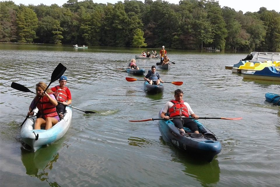 US schoolers kayaking working on team building and enrichment skills
