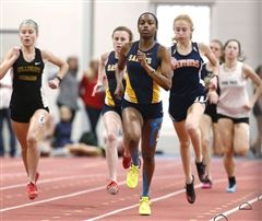 Emma Ballantyne of St. Catherine's leads the way in the 500 meters in the VISAA State Championship at St. Christopher's. Ballantyne went on to win the event. (Mark Gormus/Times-Dispatch)