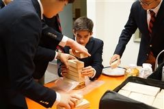Annie Wright Upper School boys practice stacking waffles and blocks to prepare for their world record attempt this Friday.
