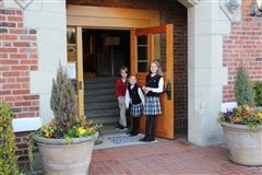 Henry, Elizabeth & Caroline greet students in the morning