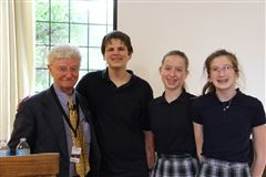 Holocaust survivor Henry Friedman poses with Grade 8 students.