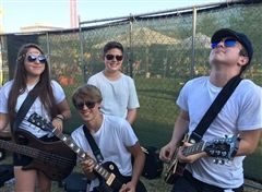 Kian Russell, far right, plays with his band Blue Avenue